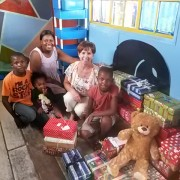Di handing over the shoeboxes